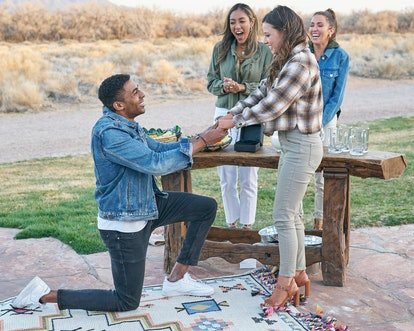 Bachelorette contestant,Josh fake-proposing to Katie on a 'Bachelorette' group date in front of hosts Tayshia and Kaitlyn.