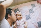 Dad kissing baby daughter on the cheek