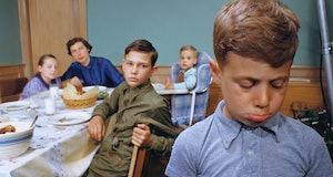boy sad at dinner