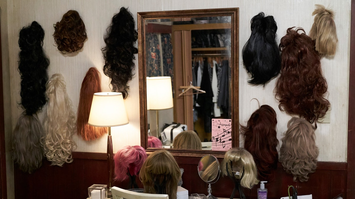Video chat in front of Moira's wig wall with these 'Schitt's Creek' backgrounds for Zoom.