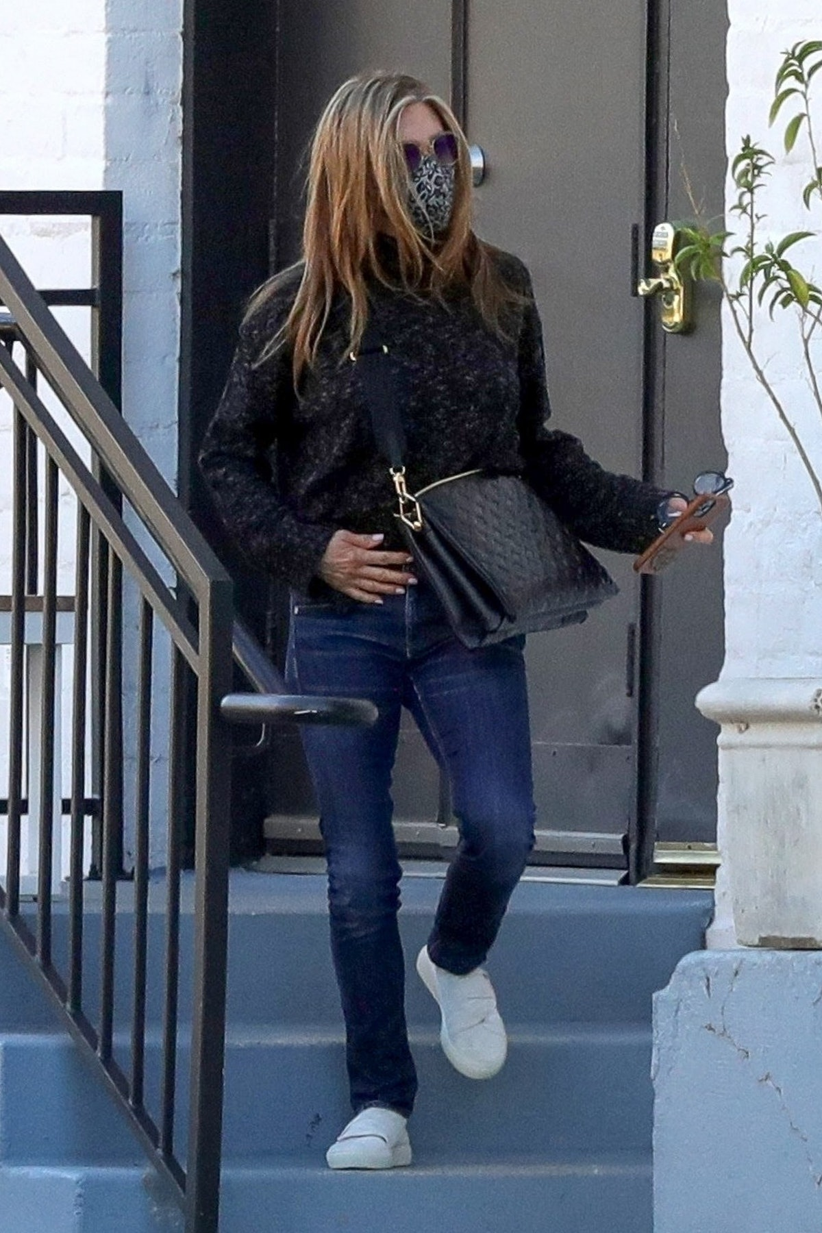Jennifer Aniston wears Louis Vuitton Coussin bag while out and about in Beverly Hills on March 15, 2...