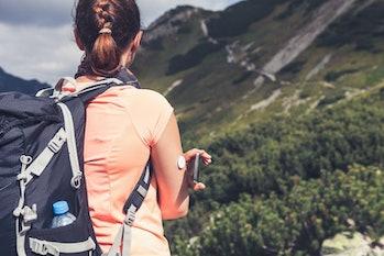 woman hiking with sensor on arm