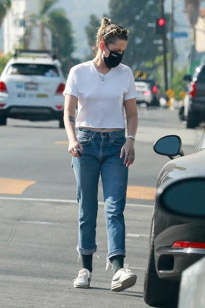 Kristen Stewart wearing jeans.