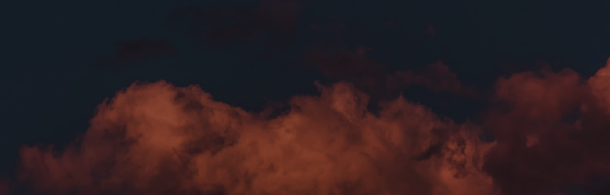 The full moon above pink clouds