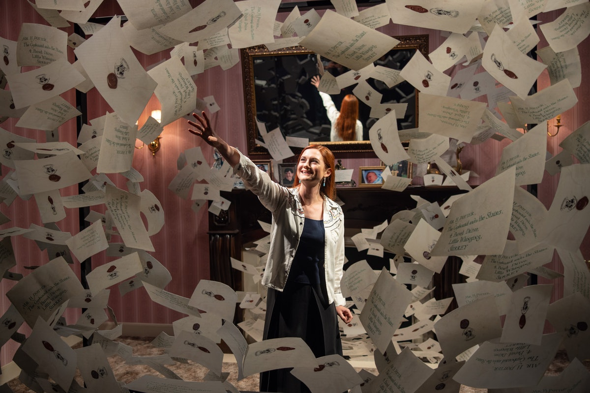 Bonnie Wright from the 'Harry Potter' films reaches for a Hogwarts letter in a photo opp at the Warner Bros. Studio Tour in Hollywood.