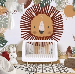 baby nursery with lion wallpaper