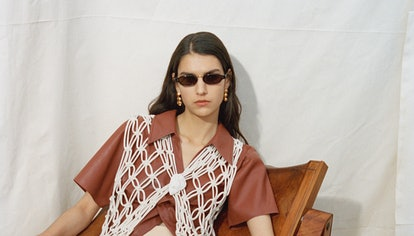 Nanushka model wears a sunglass from their Spring/Summer 2021 collection.