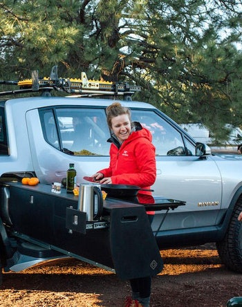 A Rivian R1T electric pickup truck with the Camp Kitchen accessory. EV. EVs. Electric cars. Automoti...