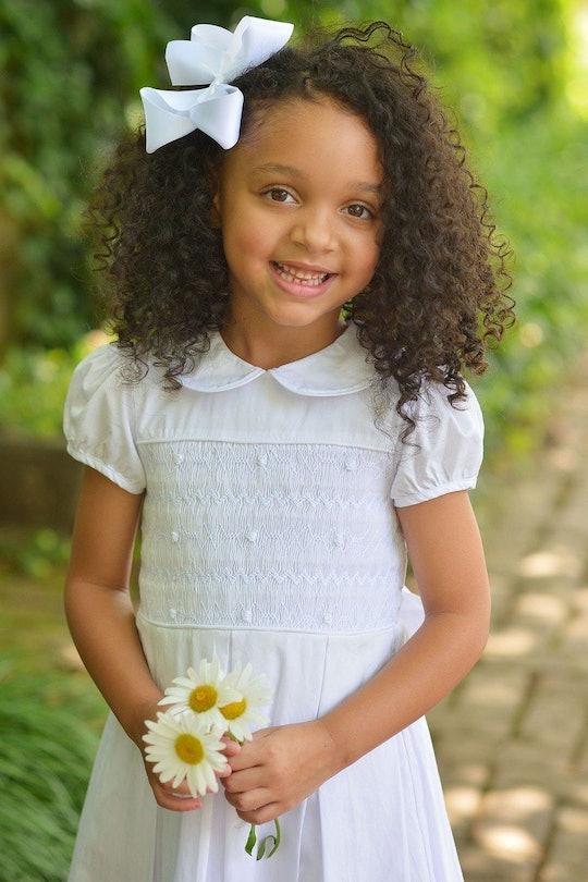 little girl in first communion dress