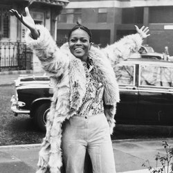 Portrait of Academy Award winning American actress Cicely Tyson smiling and raising her arms in the ...