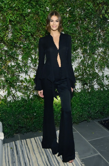Kaia Jordan Gerber attends A Sense Of Home's First Ever Annual Gala in full Khaite look and a Jimmy Choo red clutch at The Backyard Bowl at a Private Residence on November 01, 2019 in Beverly Hills