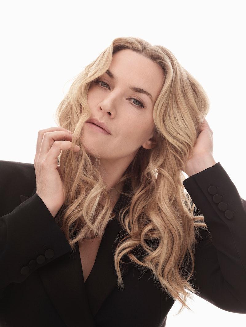 kate winslet posing for a portrait in a black blazer