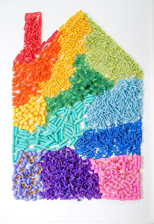 sensory play art in the shape of a house with chimney