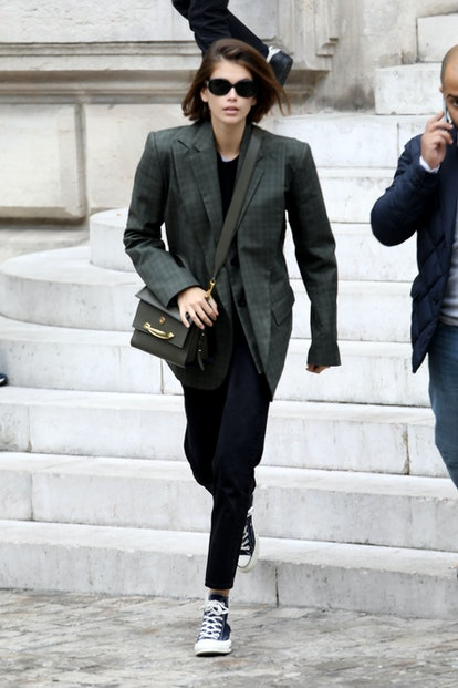 Model Kaia Gerber dons an imitable oversize blazer-and-joggers look while leaving the Stella McCartney Spring/Summer 2020 show during Paris Fashion Week on September 30, 2019.
