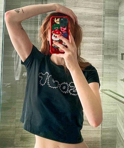 Sophie Turner red hair mirror selfie 2021 in Olivia Rodrigo Sour shirt
