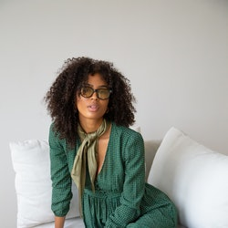 Model wears a green maxi dress from Past Life the Collective.