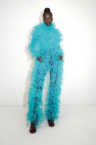 model in aqua outfit