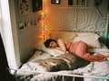 Young woman laying in bed, having vivid dreams during moon transit via specific zodiac sign.