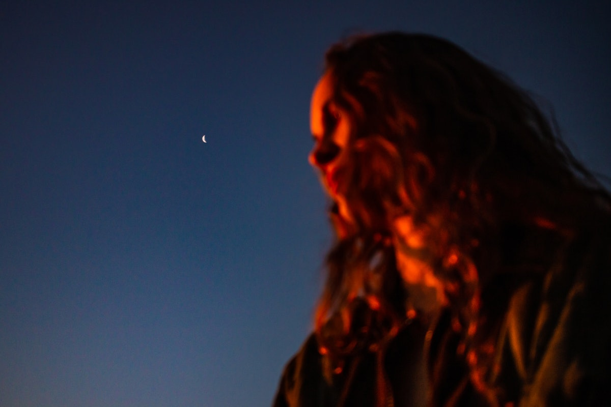 Young woman in the moonlight to show when your dreams will be the most vivid, per your zodiac sign.