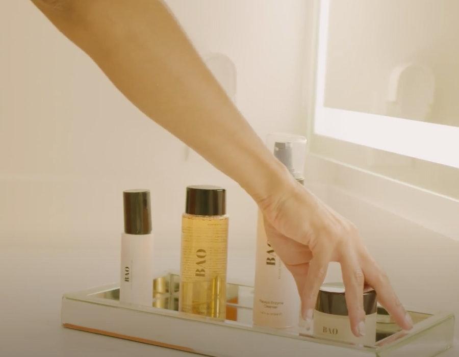 Woman hand reaching for BAO Essentials