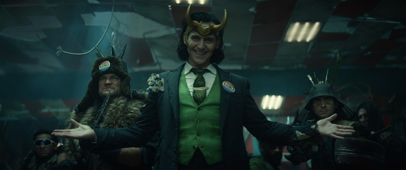 A photo of Loki, the god of mischief, posing smugly with his arms extended wide.