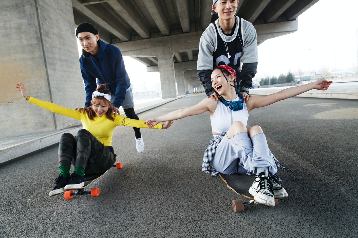 Young group of friends skateboarding.