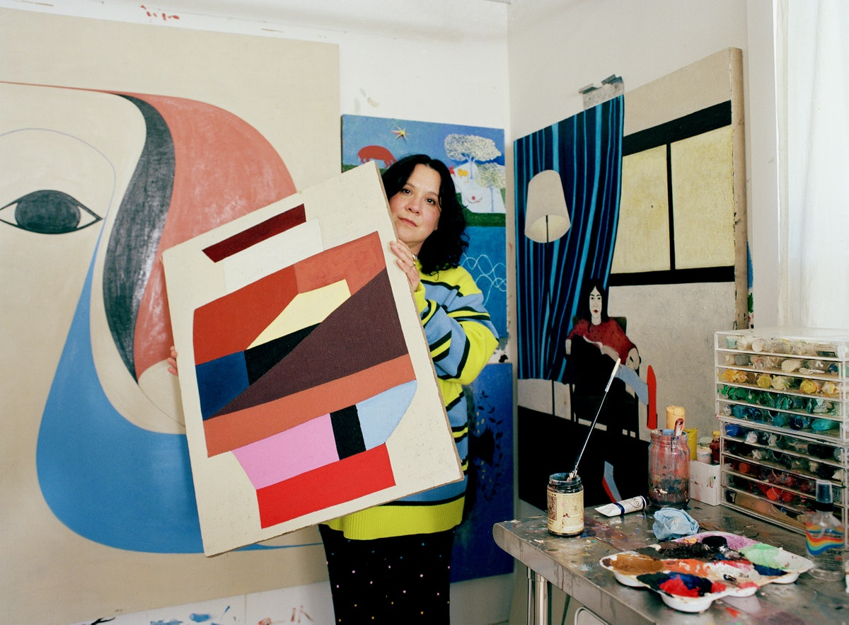 Clare Rojas holds a painting