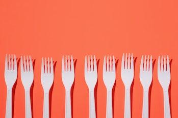Plastic forks on red background