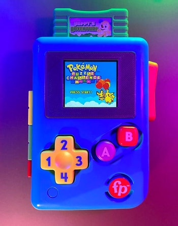 A modded Game Boy mashed with the Fisher Price Lil' Gamer. Video games. Game consoles. Gaming. Toys. Modding.