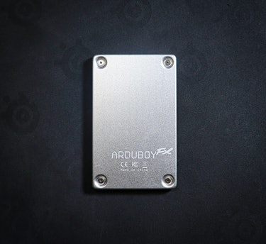 Pop off a few screws and you can easily get access to the Arduboy FX's guts. Go ahead and go nuts modding it.
