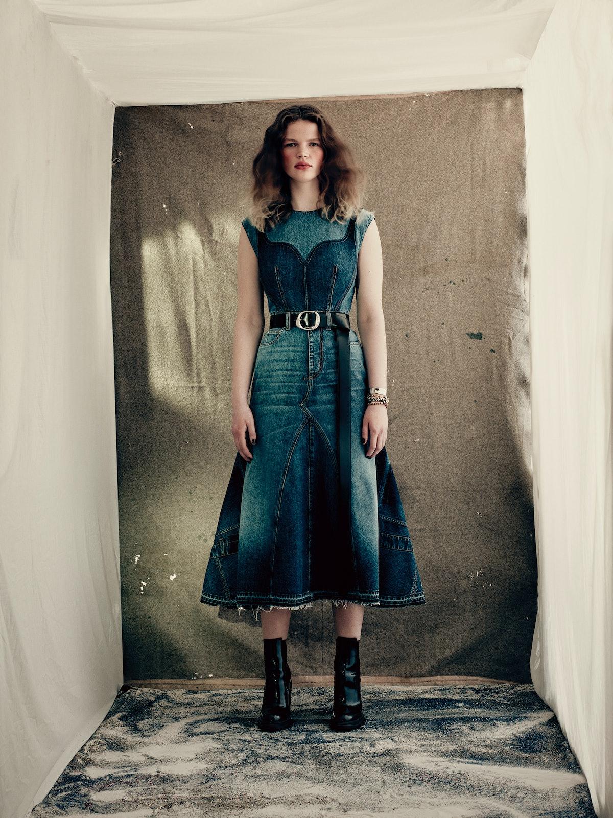 model in denim dress by Alexander McQueen