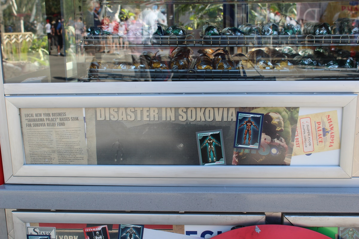 Newspaper clippings from different Marvel movies are Easter eggs on the Shawarma Palace cart in Disneyland's Avengers Campus.