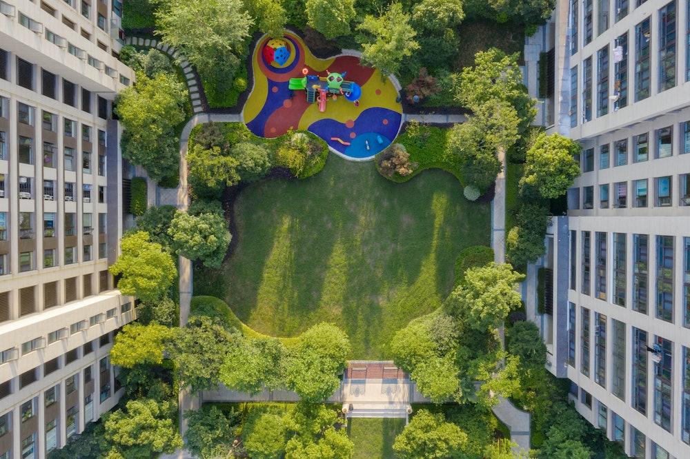 Aerial view of park between residential buildings