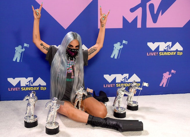Lady Gaga with her VMA statues in 2020.