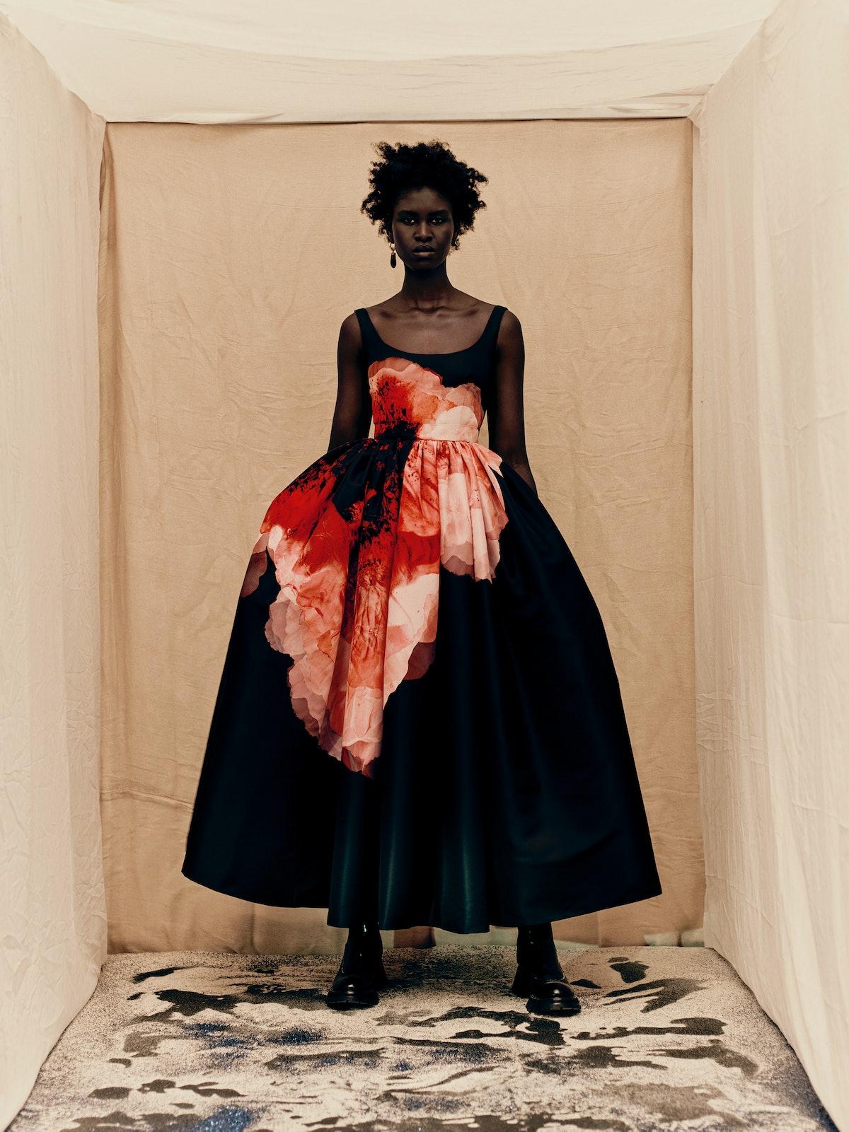 model in floral dress by Alexander McQueen