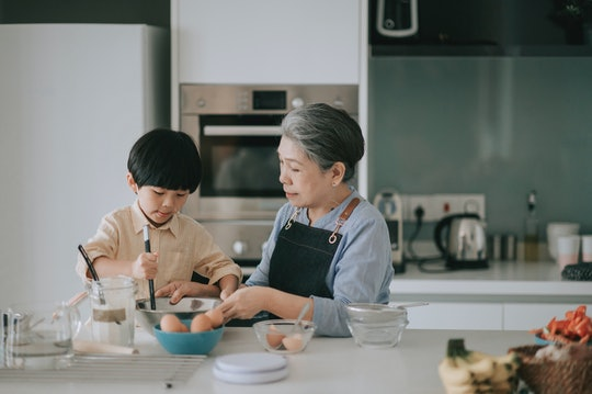 grandmother and grandson baking in the kitchen