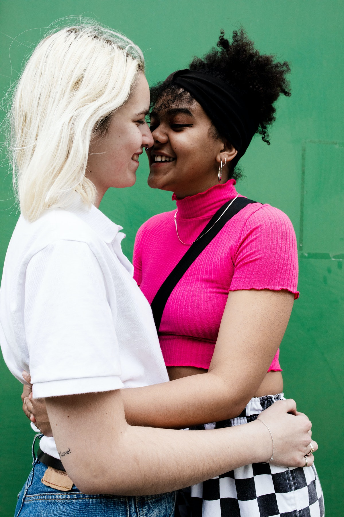 Young women close to kissing, learning how to get turned on via their Eros sign.