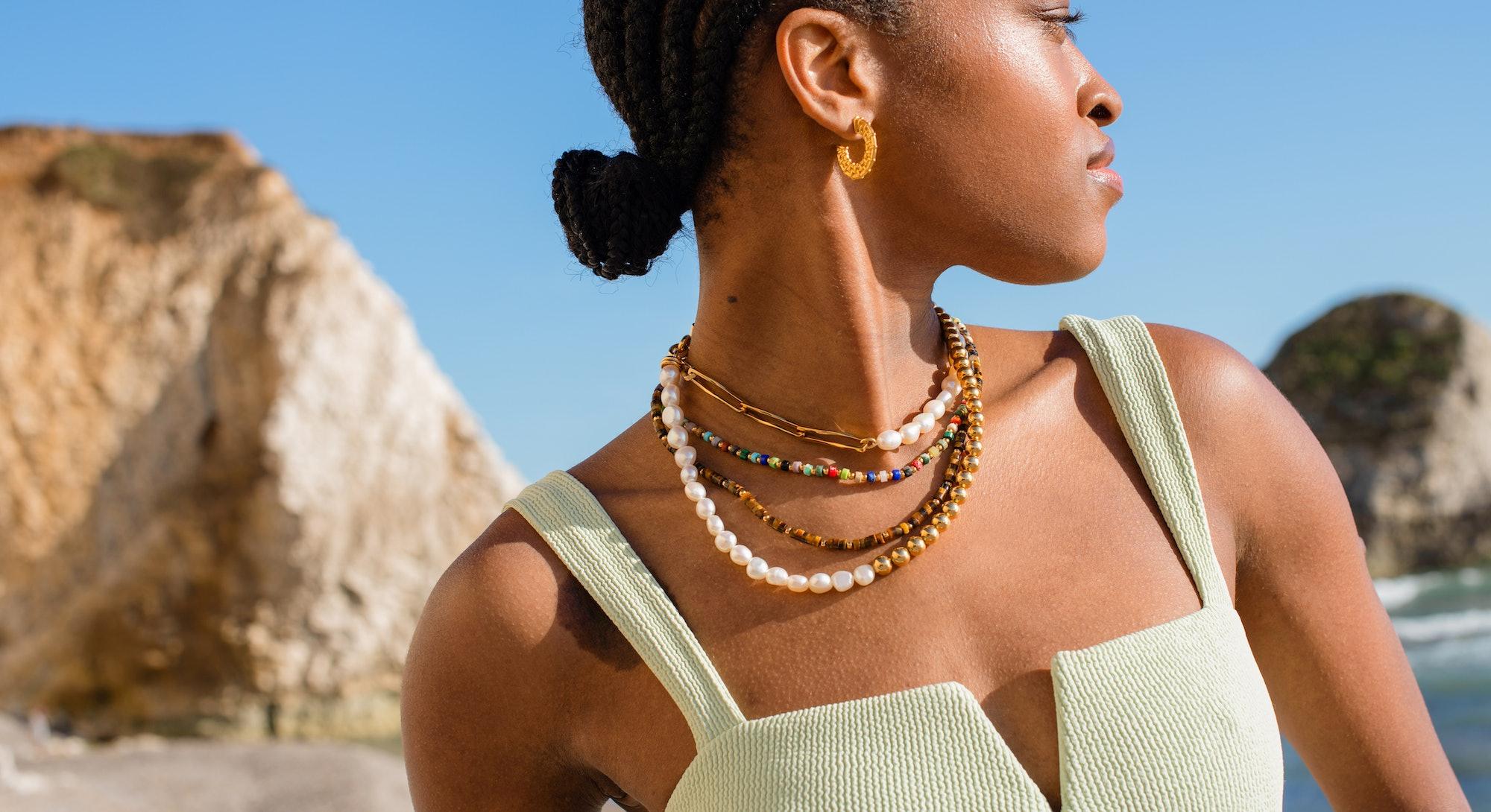 Model wearing Missoma beaded necklace.