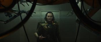 Tom Hiddleston wearing green and gold armor in Loki Episode 1