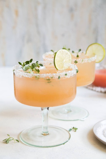 honey thyme margarita with lime wedge and salted rim