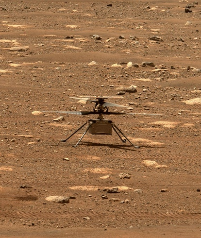 NASA Ingenuity helicopter from afar on the surface off Mars.