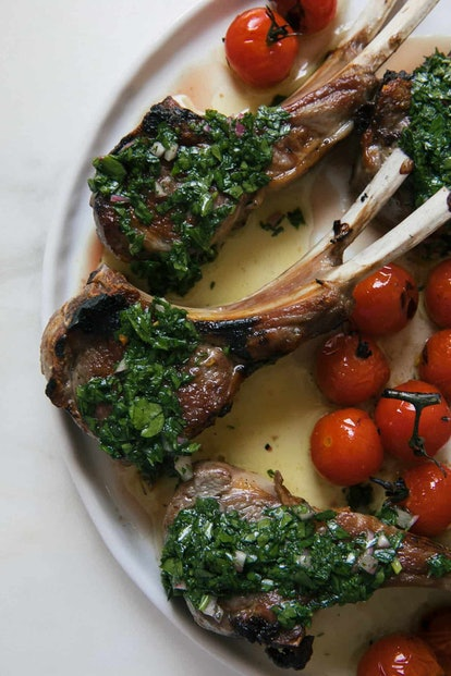overview shot of chimichurri lamb chops with small tomatoes