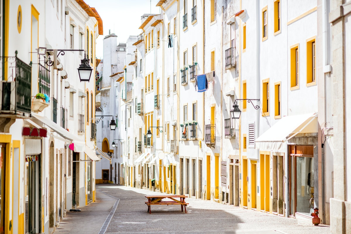 Street view of Evora, a city in Portugal that makes for a great under-the-radar travel destination.