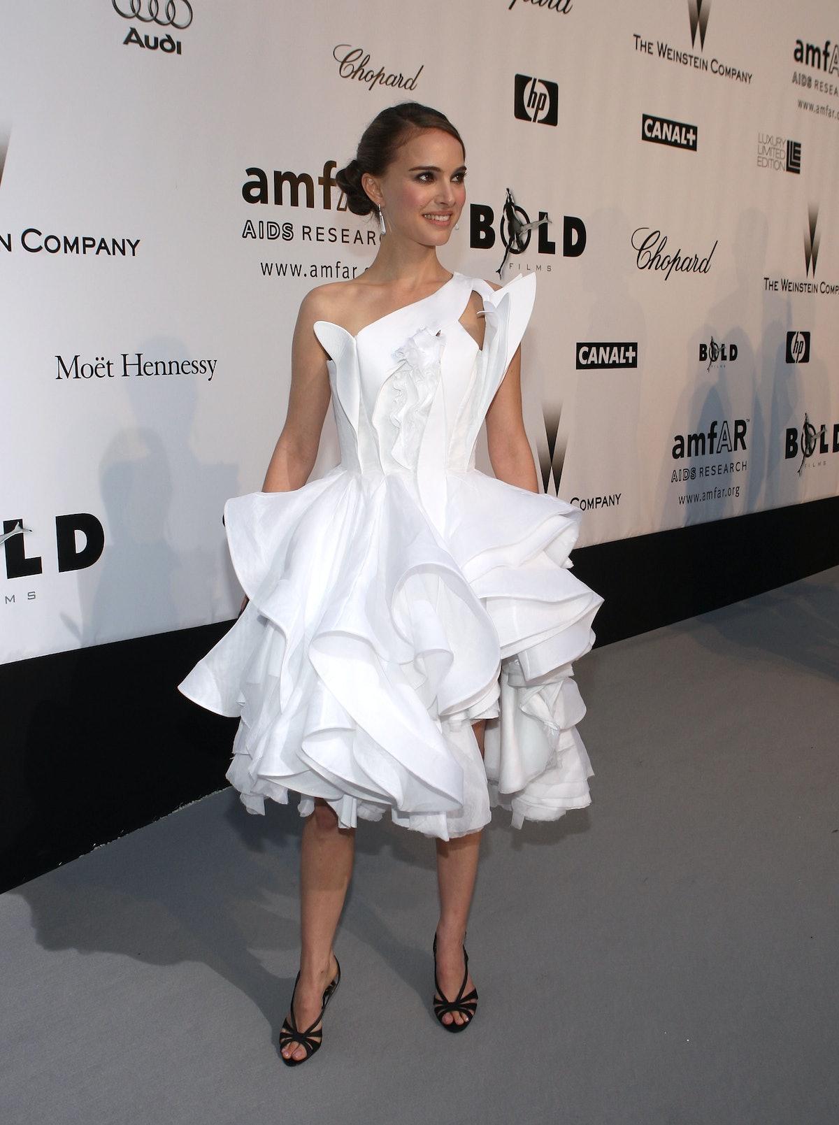 Natalie Portman in white sculptural dress.