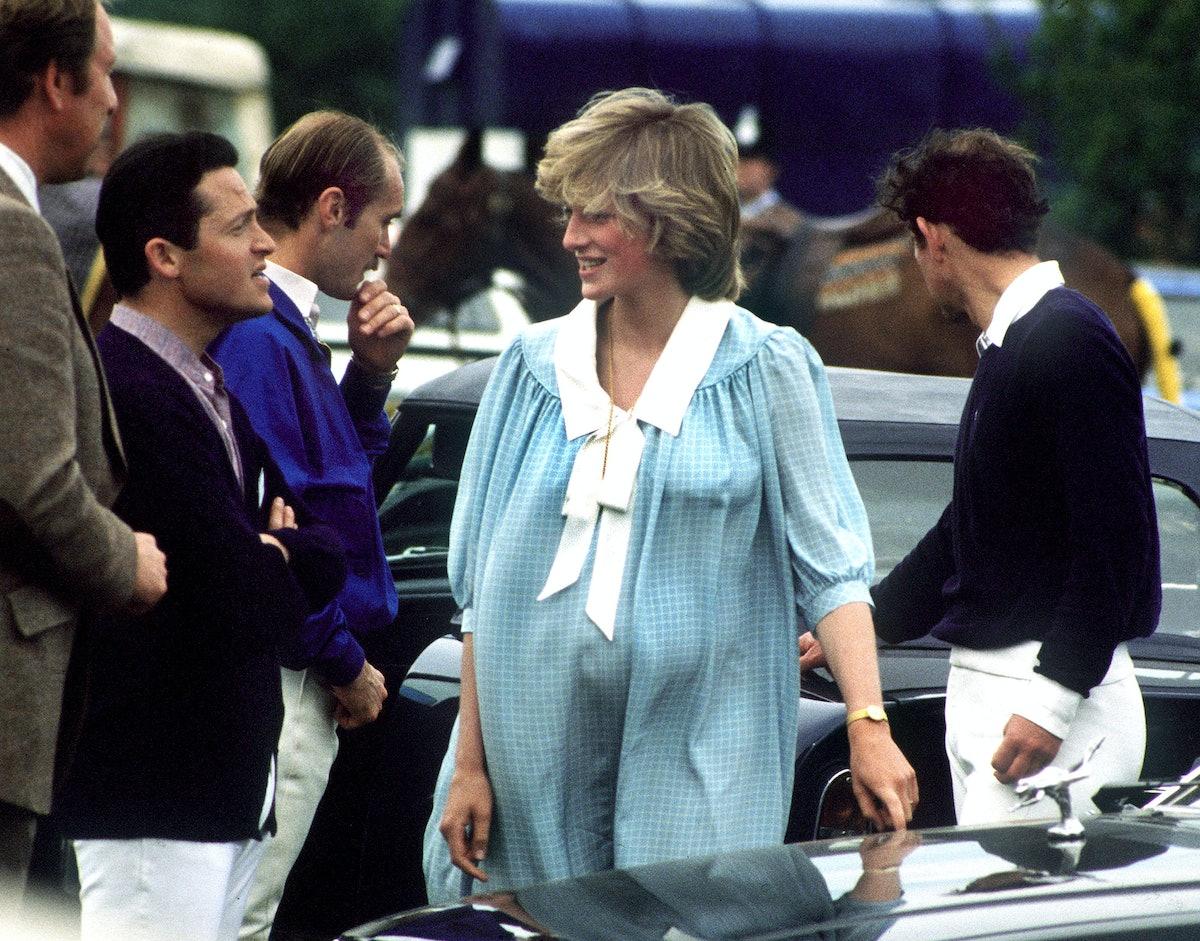 A pregnant Princess Diana wearing a blue sailor dress