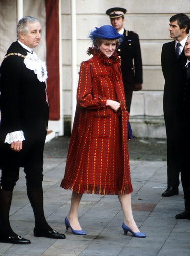 Princess Diana wearing a red coat