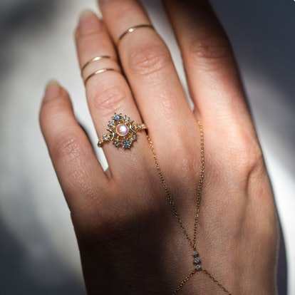 A model wears a moonstone engagement ring.