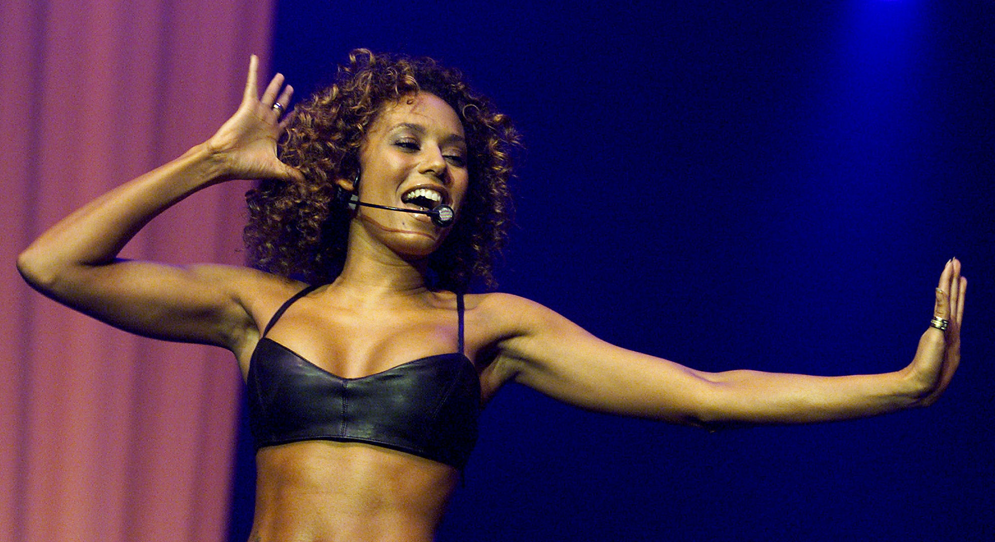 Mel B performing with the Spice Girls.