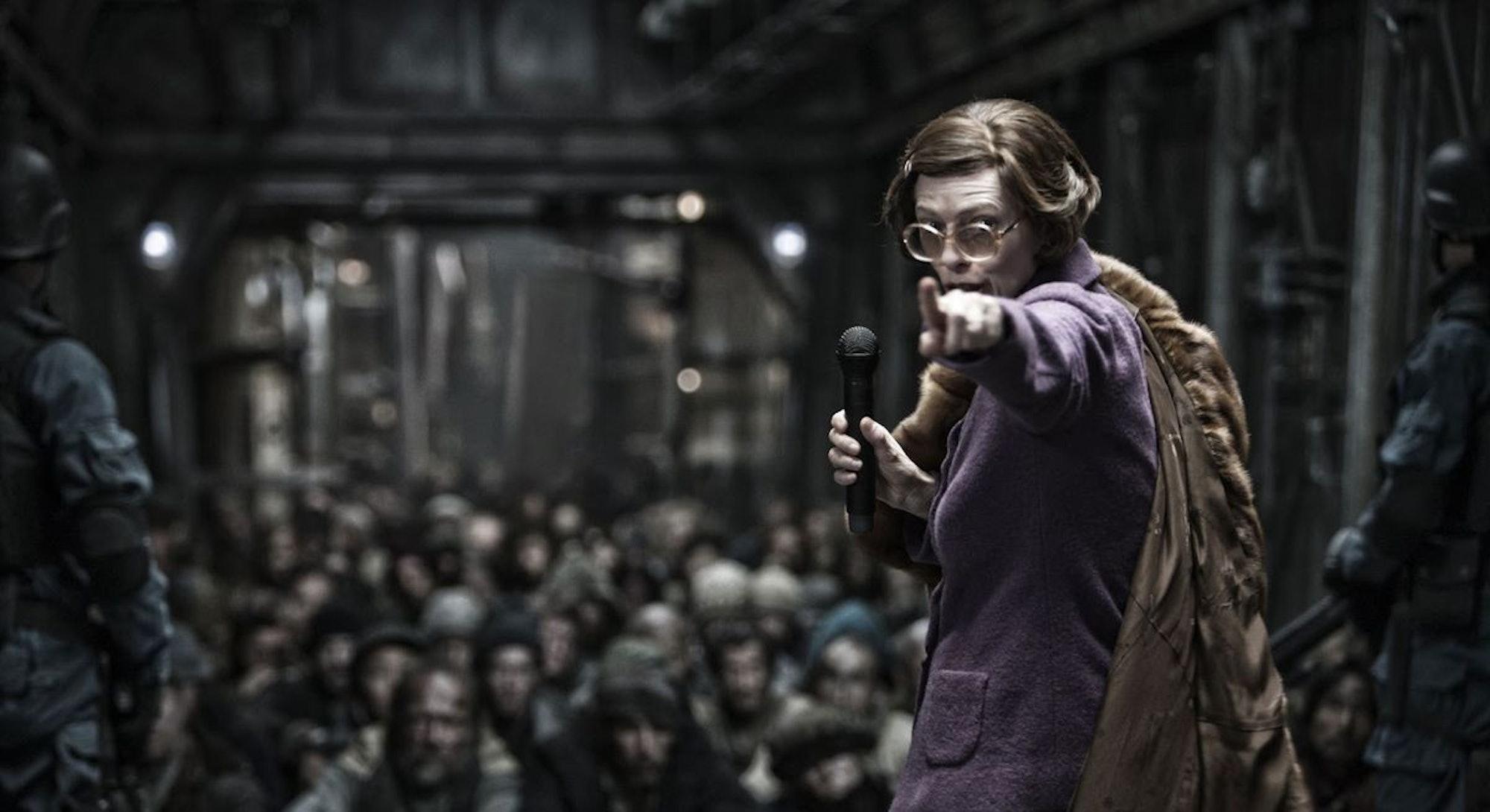 tilda swinton in purple suit and cape from snowpiercer