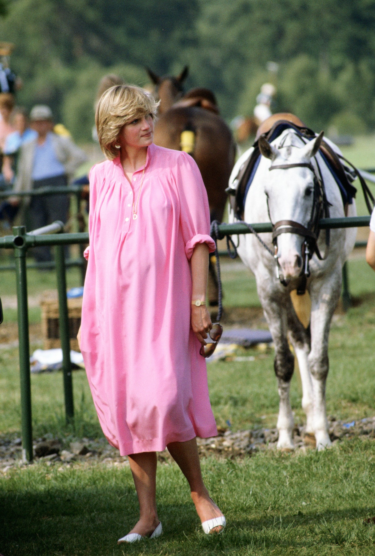 Princess Diana wearing a pink dress